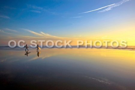 Surfers on the Beach at Low tide in Huntington Beach during Sunset